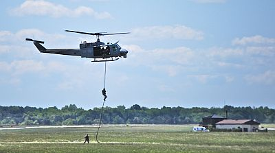 UH-1N HMLA DET B  Inserting  repellers