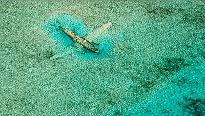 Ditched Curtiss C-46 near Normans Cay in the Bahamas by Bjorn Moerman