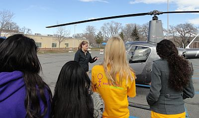 Volunteer/Pilot Chelsea Tugaw explains preflighting Upper Limit's R22