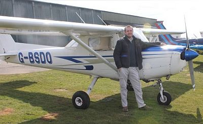 Jason Smart with his training aircraft