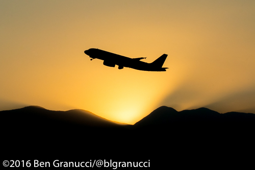 A LAN Airlines A320 departs Santiago, Chile at sunset.