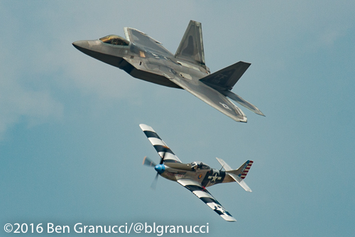 An F-22 Raptor and P-51 Mustang perform the Heritage Flight during day 2 of the first ever New York Air Show.