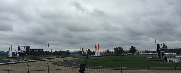 Race plane, airliner, and  helicopter at the Red Bull air race