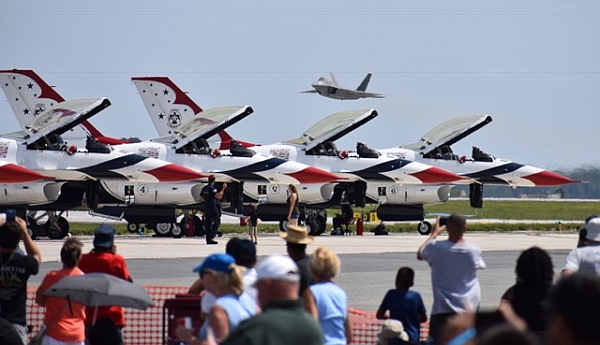 Thunderbirds and F-22 by David Vanderhoof.
