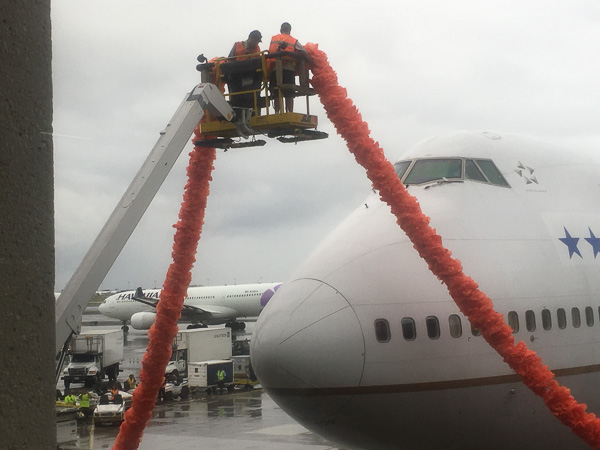 The Boeing 747 gets a lei on arrival in Hawaii.
