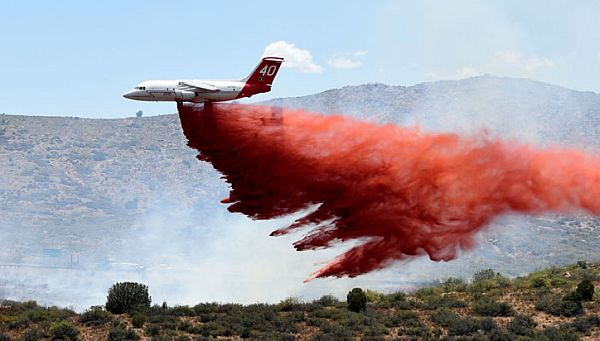 Aerial firefighting with the BAE 146-200 jet. Courtesy Neptune Aviation Services.