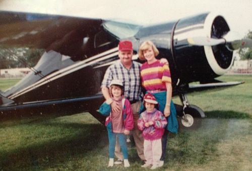 Kelly's family in front of the Staggerwing at Oshkosh.