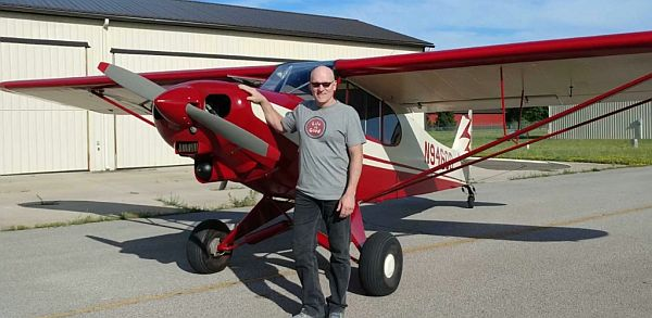 Martt Clupper and his restored 1959 Super Cub.